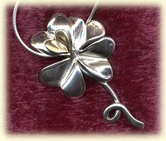 Small and Large Four Leaf Clover-Gold Heart-Silver Chain