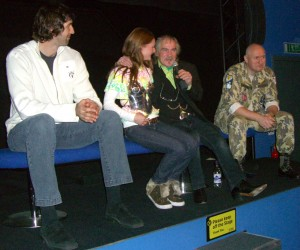 Myrea Pettit on stage with Terry English and the Predator